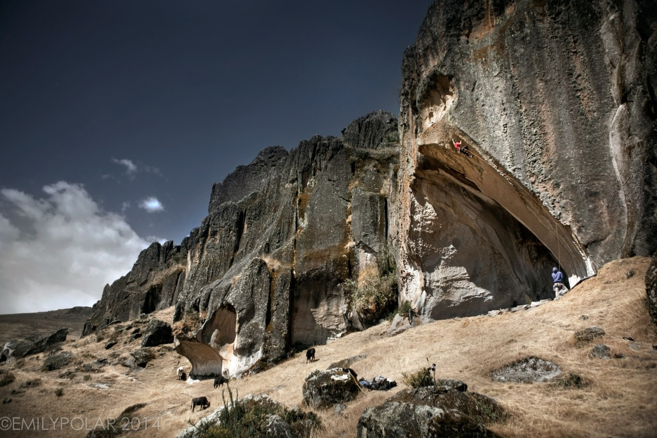 Climber leading up 13a in Hatun Machay Peru. Rock climbing at 4200 meters in the Peruvian Andes.