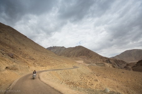 Ladakhi man riding motorcycle around Rumbak in Ladakh.