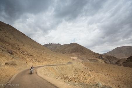 Ladakhi man riding motorcycle around Rumbak in Ladakh.