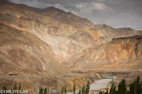 Road and bridge to Takmachik Village in Ladakh along the Indus river in India.