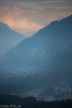 View of Manali in the foggy clouds from Vashisht at sunset.