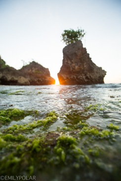 Tide coming in to the rocky shores of Bingin Beach at sunset.