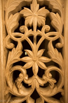 Window carved from stone in shape of flowers at the City Palace of Udaipur.