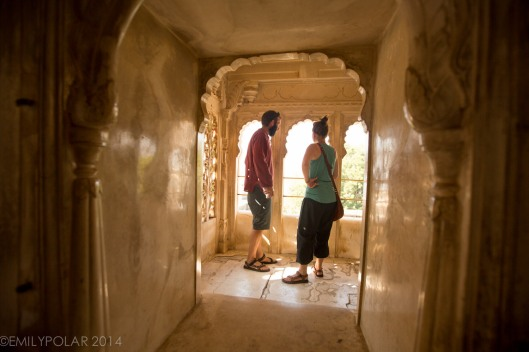 Western couple exploring the many rooms in the City Palace at Udaipur.