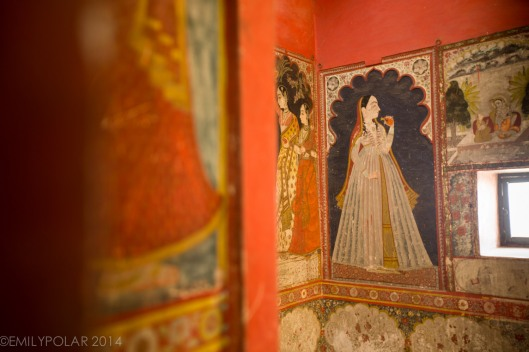 Paintings along the walls of the City Palace in Udaipur.