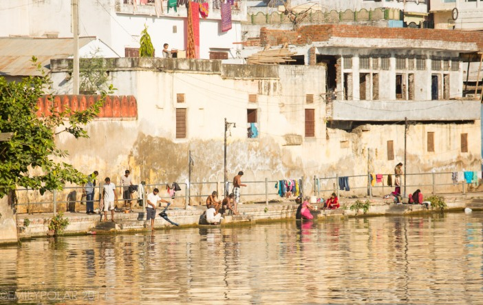 People washing clothes along the river in Udaipur, Rajasthan.