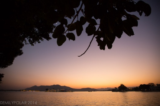 Sunset over lake Pichola with a view of Taj Lake Palace in Udaipur.