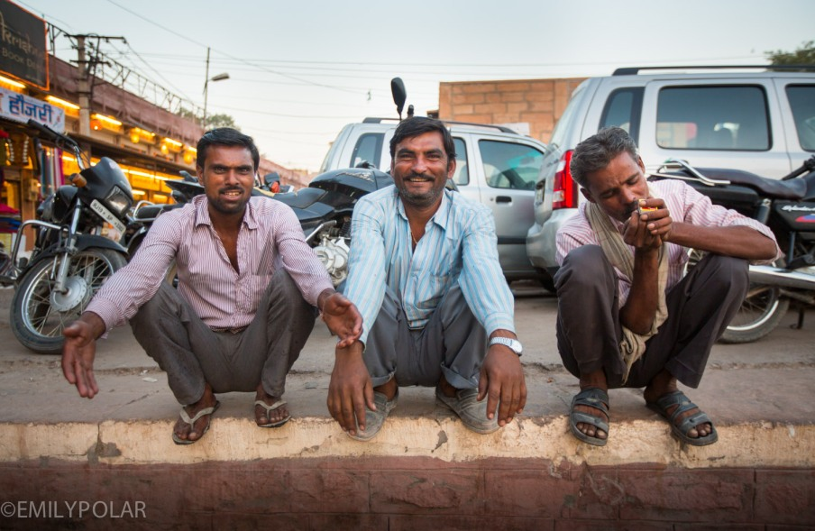 Three Indian men just chilling on the curb in Jodhpur, Rajasthan.