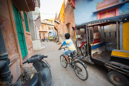 Young Indian boy riding big bicycle down the streets in Jodhpur.