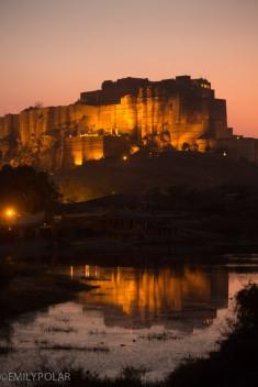 Mehrangarh Fort lit up under the night sky in Jodhpur, Rajasthan.