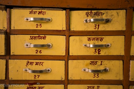 Yellow drawers filled with spices in spice shop in Jodhpur.