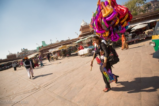 Young Indian girl selling big balloons in the streets of Jodhpur.