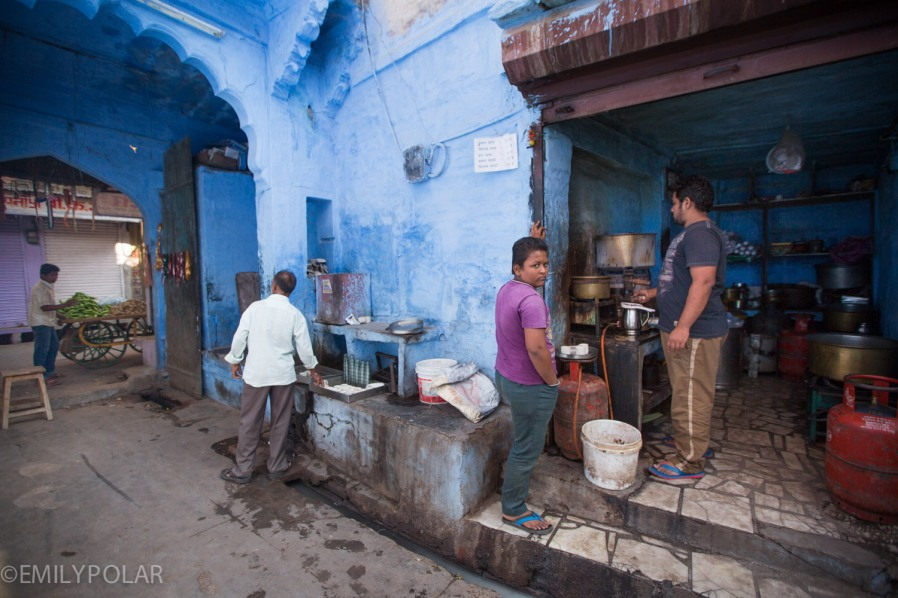 Indian men getting chai down a blue alley in Jodhpur, Rajasthan.
