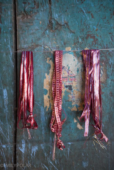 Ribbons hanging on a blue wall in Jodhpur, Rajasthan.