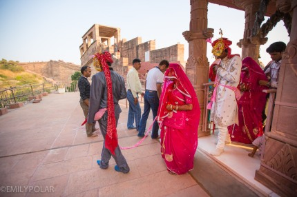 Indian man and woman getting married at Mehrangarh Fort in Jodhpur, India.