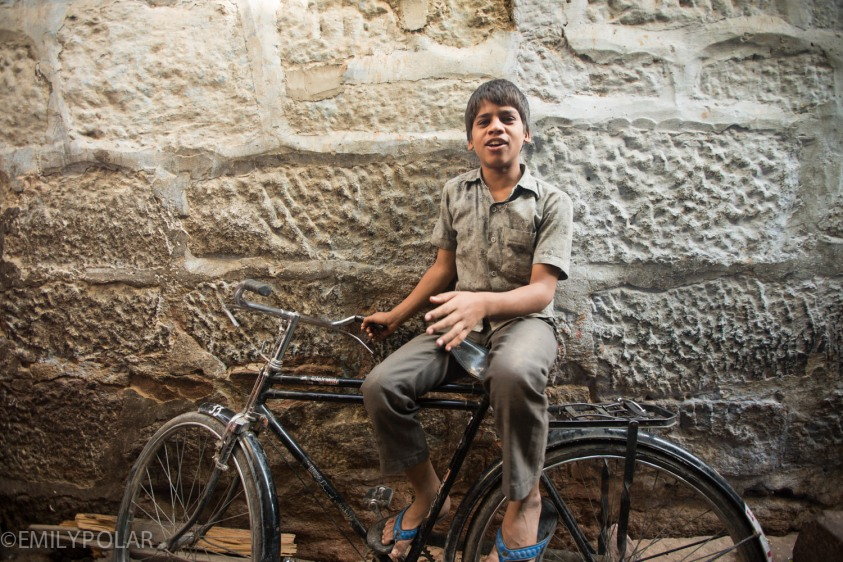 Portrait of a young Indian boy on his bicycle in the alleys of Jodhpur.