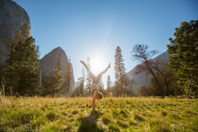 Woman doing yoga at sunset on a warm spring day in El Cap Meadow of Yosemite Valley.