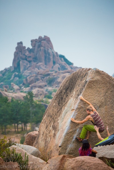 Man bouldering arete in Hampi, India.
