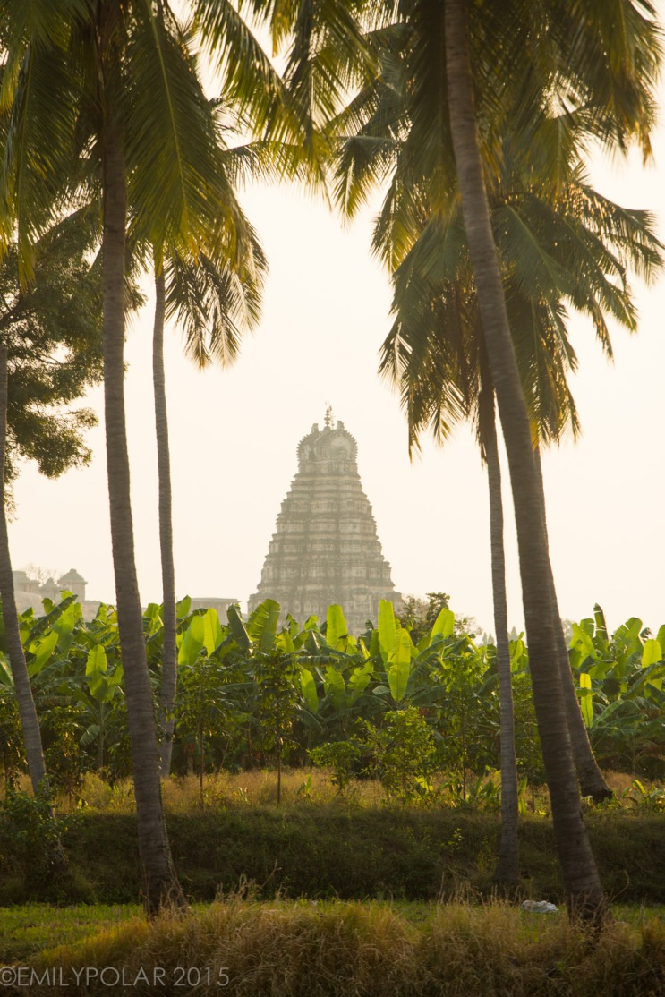Holy temple framed between two palm trees in Hampi.