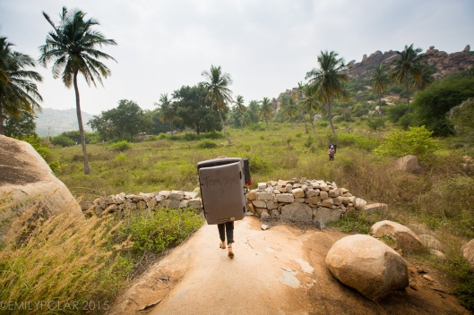 Woman climber carrying Tom and Jerry crash pad in Lands End, Hampi.