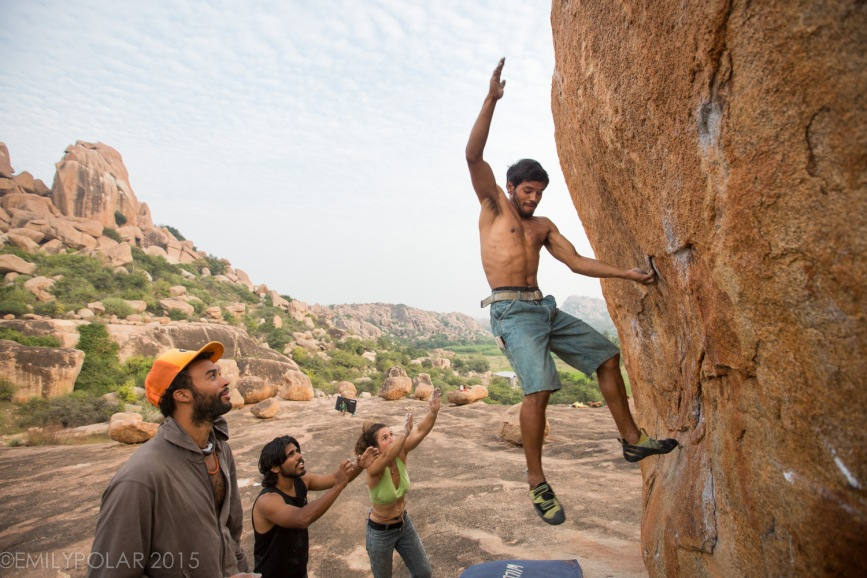 Indian man bouldering at the plateau in beautiful Hampi, India.