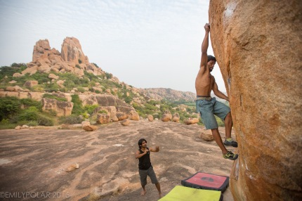 Indian men bouldering at the plateau in beautiful Hampi, India.