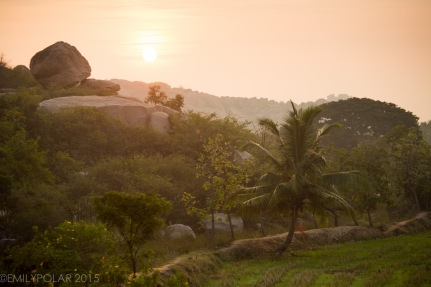 Sunrise over the plateau of boulders and rice fields of Hampi, India.
