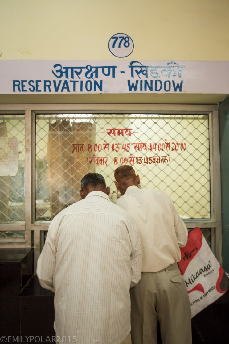 Two men buying train tickets at the station in Jaisalmer, Rajasthan.