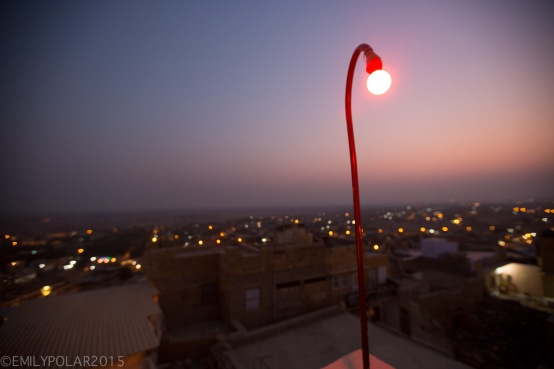 Red light bulb curves over the city of Jaisalmer at sunset in the desert of Rajasthan.