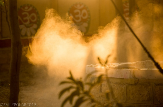 Dust rolling in the early morning rays of light glowing golden it's particals rise in a Temple of Jaisalmer.