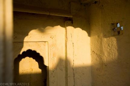 Sun light shinning through window to light up wall inside of temple at Sagar Lake.