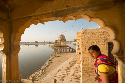 Indian woman looking out from the stairs of her house on Sagar lake in Jaisalmer, Rajasthan.