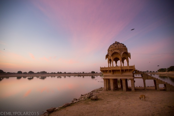 Warm light at sunrise over lake Sagar at Amar Sagar temple in Jaisalmer.