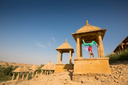 Woman doing handstands inside the Chhatris at Bada Bagh in Jaisalmer, Rajasthan.