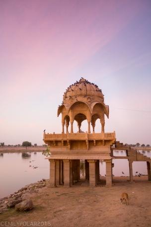Warm light at sunrise over lake Sagar at Amar Sagar temple in Jaisalmer.