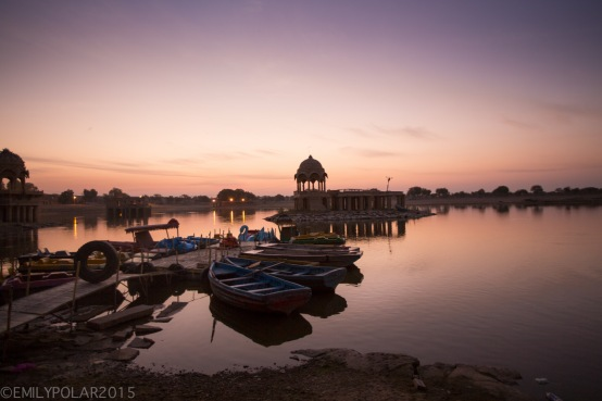 Dawn breaking over the boast and dock at the Amar Sagar temple complex and lake in Jaisalmer.