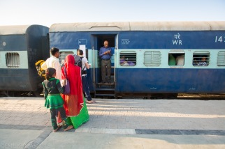 Locals and travelers waiting for the train at Jaisalmer station.