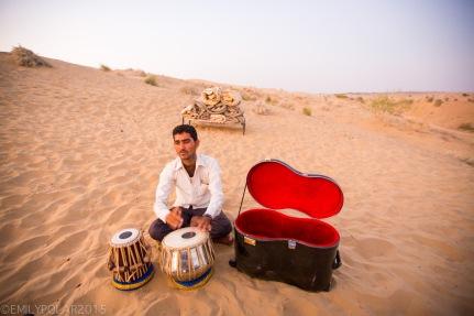Rajasthani man playing Tablas in the Thar desert of Rajasthan.