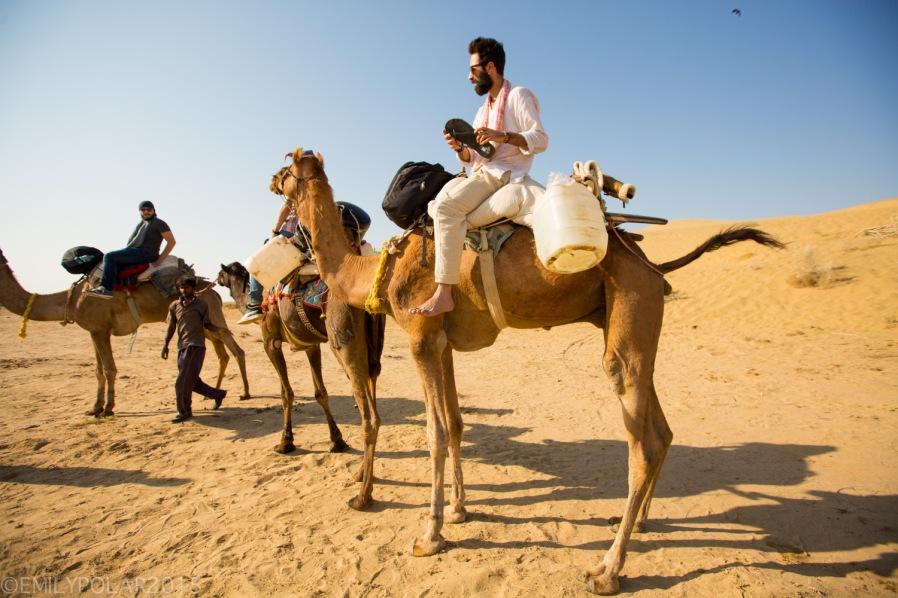 Italian men on camel safari in Thar desert, India.
