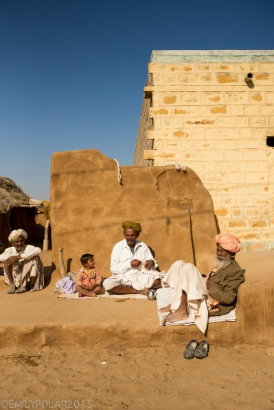 Rajasthani men sitting in front of their mud home in a small village of Thar desert, India.