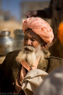 Rajasthani man sitting in front of hus mud home in a small village of Thar desert, India.