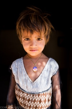 Portrait of a young Girl in doorway of her home deep in the Thar Desert of Rajasthan.