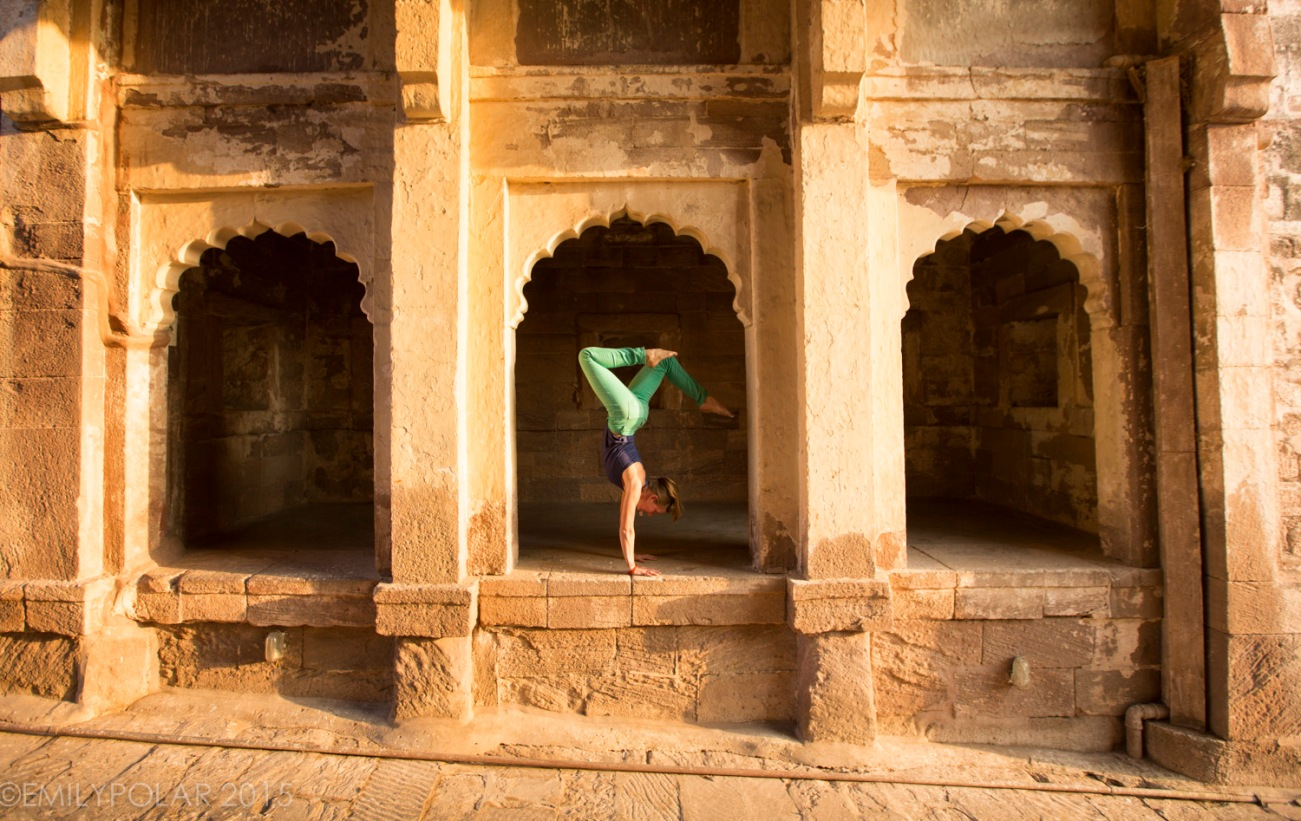 Woman doing handstands at Mehrangarh Fort in Jodhpur.