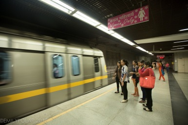Women riding in the women only cabin on the metro in Delhi, India.