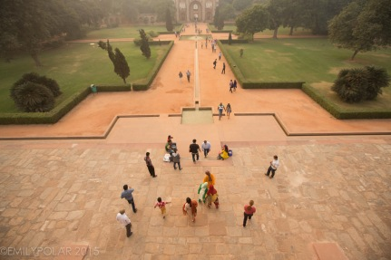 Tourists walk around and hang out on the grounds of Humayuns Tomb in Delhi, India.