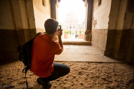 Man taking a picture with his smart phone in one of the mosques at Lodi Gardens, Delhi.