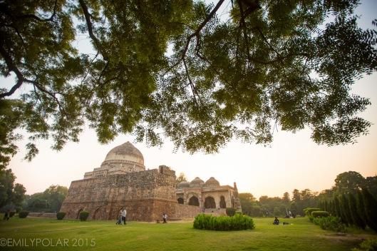 Golden dusk at Bara Gumbad tomb and mosque below the trees of Lodi Gardens, Delhi.