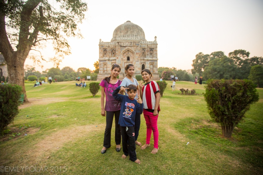 Cute brothers and sisters pose for photo at Sheesh Gumbad in Lodi Gardens, Delhi.