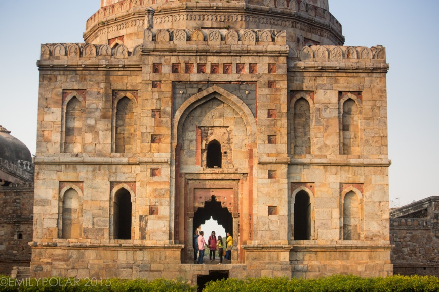 Young Indians hanging out at Sheesh Gumbad in Lodi Gardens, Delhi, India.