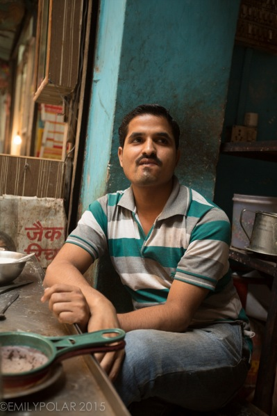 Indian man working at a cute little chai shop on the streets of Old Delhi, India.